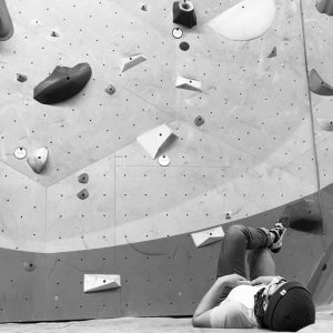 Climber laying down and observing a route